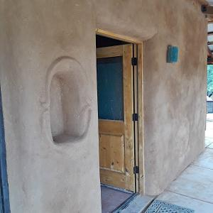 Earthen plaster project on existing, large strawbale home near Benson, AZ.