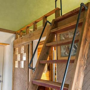 Salvaged lumber used to build this ladder for access to the loft.
